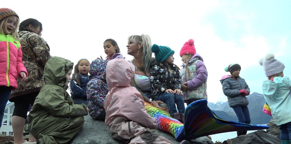 Children gather around to ask mermaid questions they may have never gotten the answers to without her.