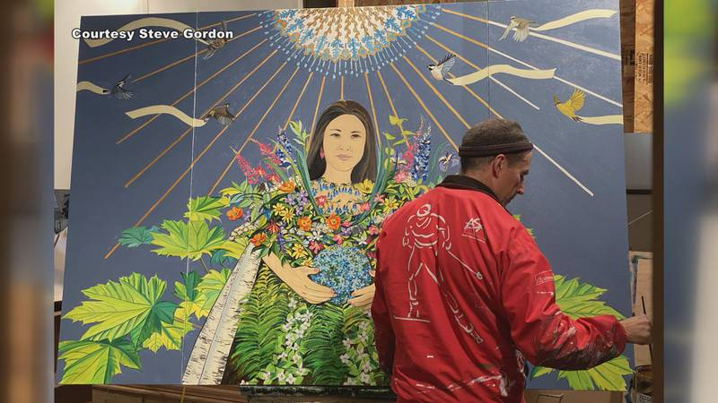Steve Gordon working on his smaller scaled painting of the Hope Wall mural.