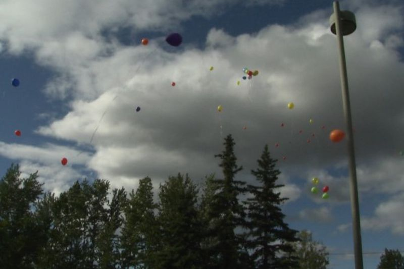 Balloons are released in memory of Katelynn Shelhamer during Saturday night's ceremony at the...