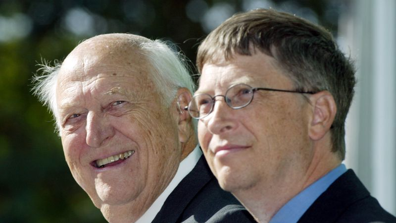 FILE - In this Sept. 12, 2003 file photo, William H. Gates Sr., left, smiles while sitting next...