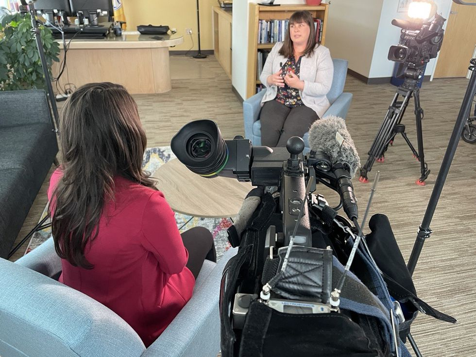 Anchorage acting mayor Austin Quinn-Davidson participates in an in-person, unmasked interview....