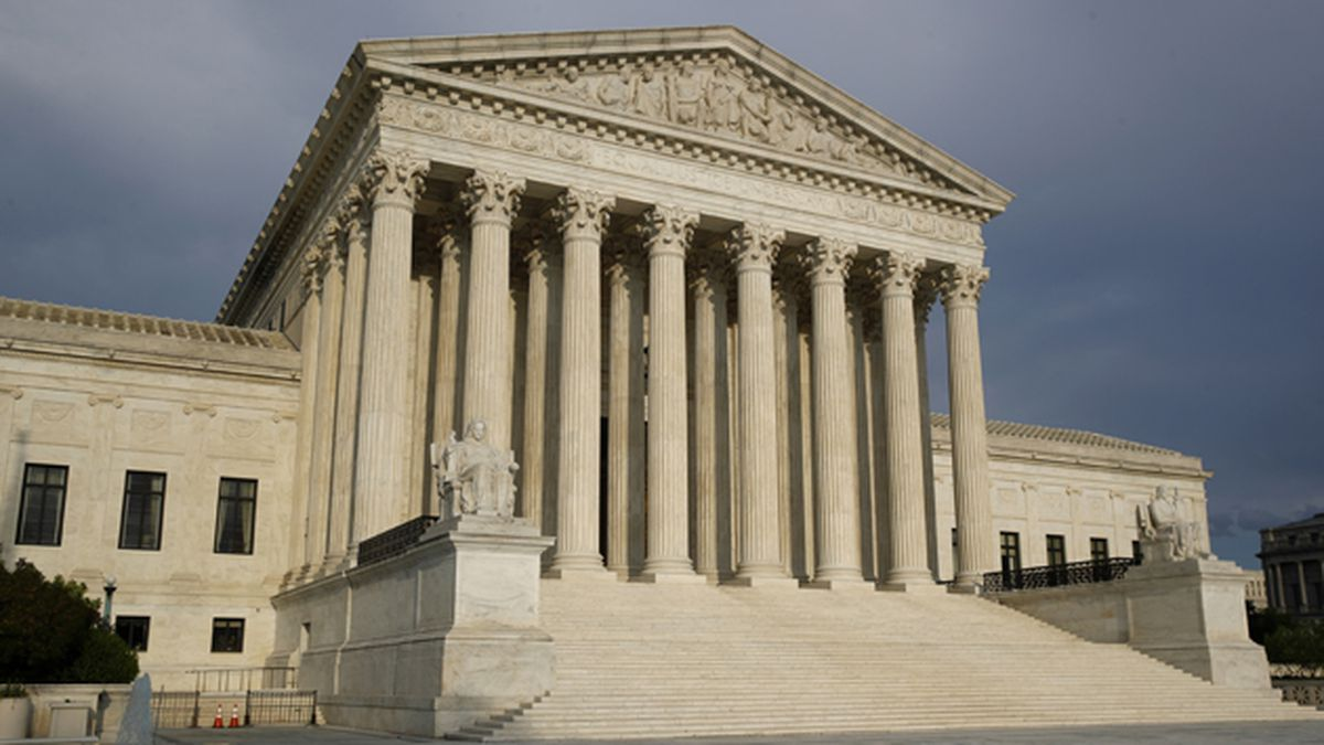 The setting sun shines on the Supreme Court building on Capitol Hill in Washington, Sunday, May...