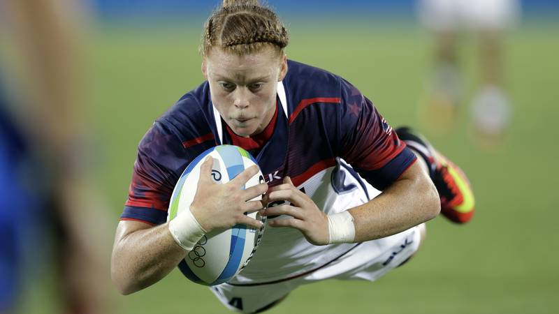 USA's Alev Kelter, scores a try during the women's rugby sevens match between USA and Colombia...