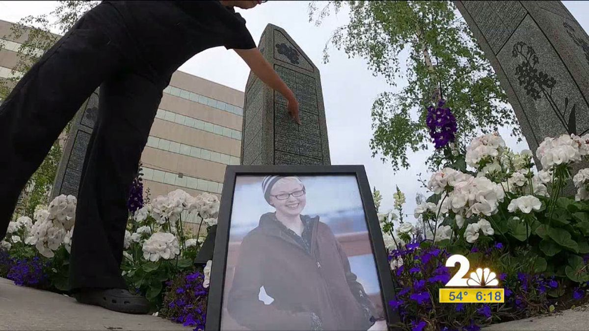 Sherry Miller points to where her daughter's name, Linda Bower is on the Victims for Justice Homicide Memorial in downtown Anchorage.