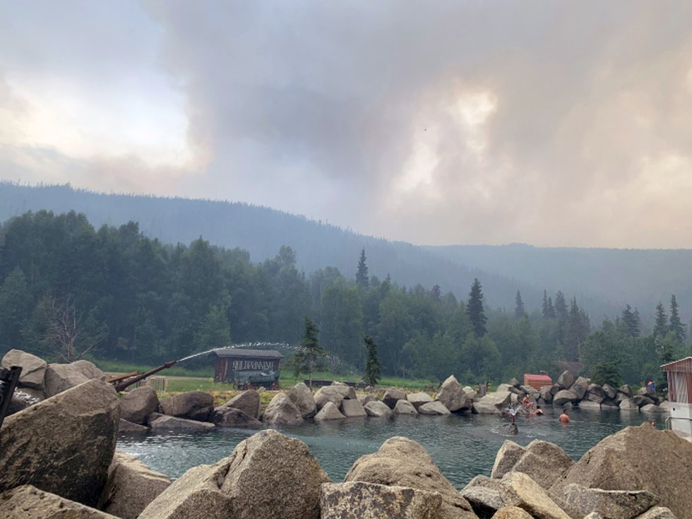 Smoke from Munson Creek fire can be seen rising behind the Chena Hot Springs on Monday, July 5,...