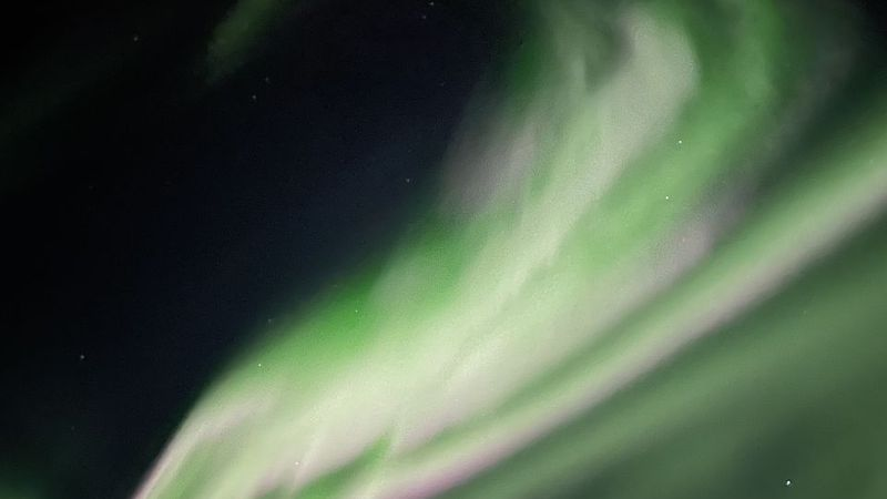 The northern lights glimmer with flashes of purple over Noatak. (Courtesy Tristen Ashby)