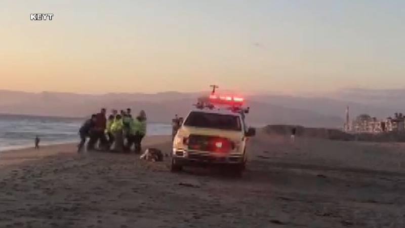 Emergency workers try to save the life of Matthew Quiner who drowned Ocotber 8 in Oxnard, CA.