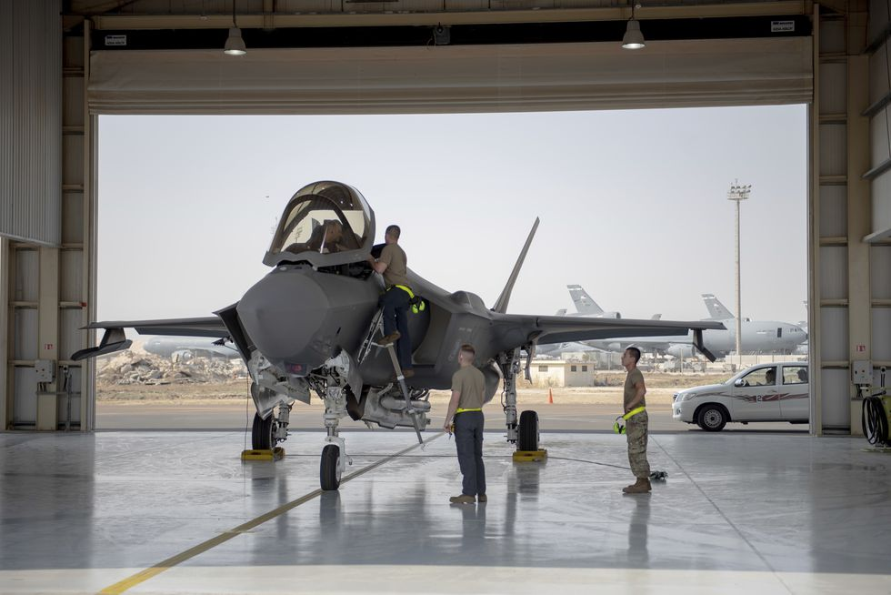 In this Aug. 5, 2019, photo released by the U.S. Air Force, an F-35 fighter jet pilot and crew...