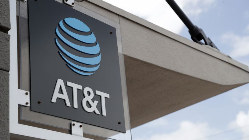 FILE - In this July 18, 2019, file photo, a sign is displayed at an AT&T retail store in Miami....