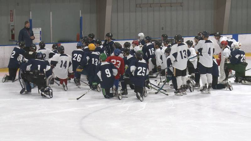 The Anchorage Wolverines on the ice during the team's 2021 training camp.