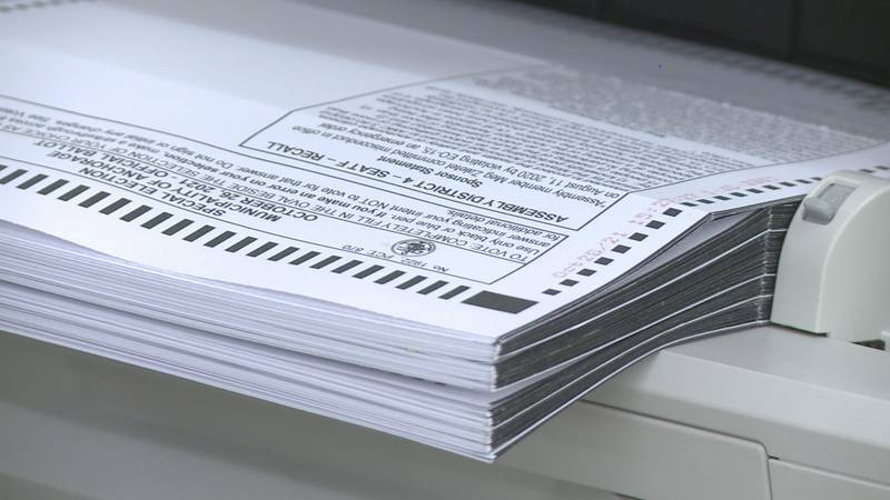 Ballots are counted during the Tuesday, Oct. 26, 2021 special election in the effort to recall...