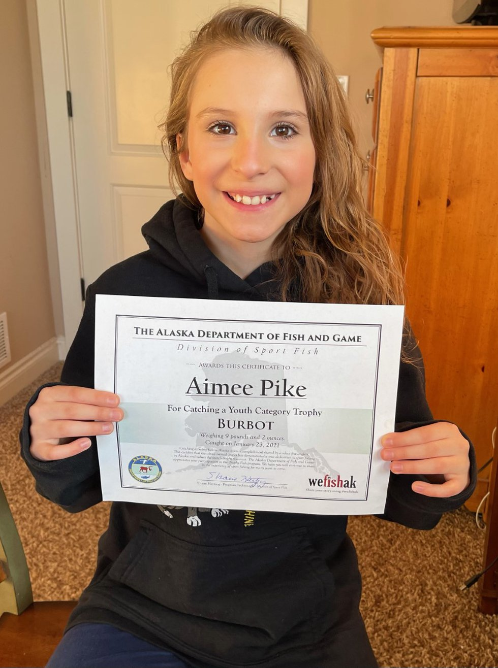 Aimee Pike holds her state record Burbot certificate from Alaska Fish and Game.