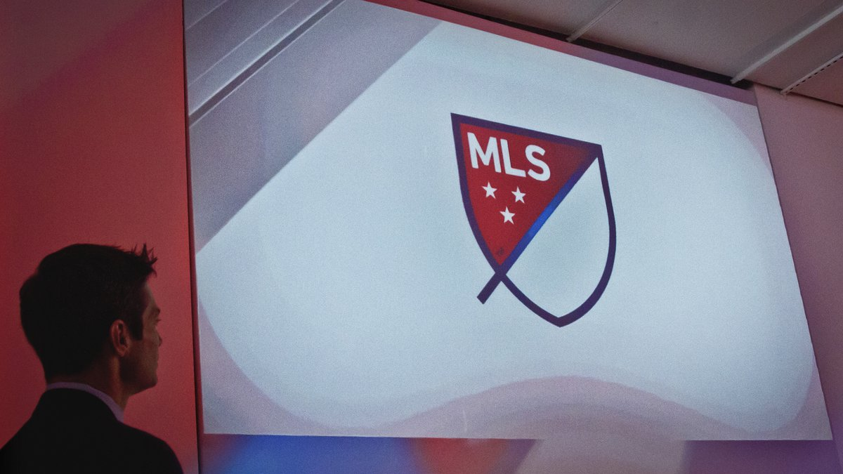 Major League Soccer's new logo is projected during a press conference on Thursday, Sept. 18,...