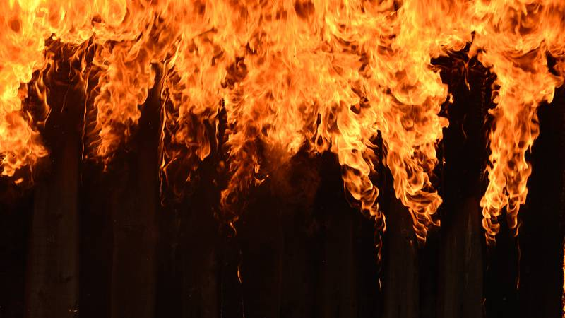 Burning wooden house close-up