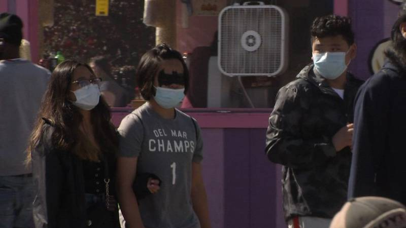 Visitors to the Alaska State Fair wear masks to help slow the spread of COVID-19.