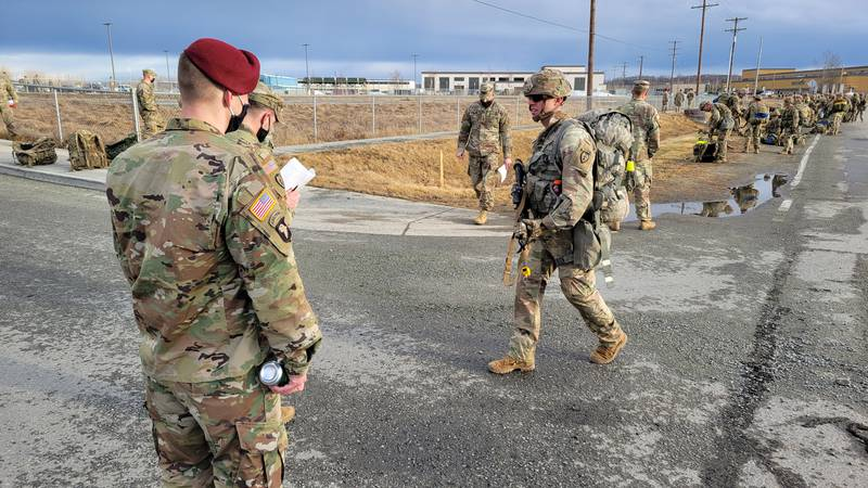Army Alaska paratroopers at JBER complete a 12-mile ruck march to earn Expert Infantry Badges...