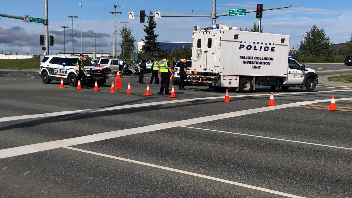 Anchorage police respond to the scene of a multivehicle crash at the intersection of East 5th...