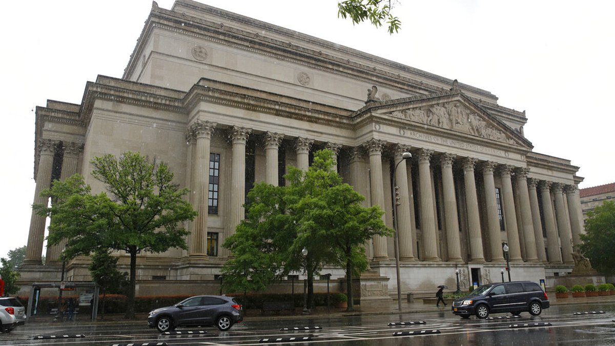 Traffic passes by the National Archives building, Friday, April 26, 2019, in Washington. An...