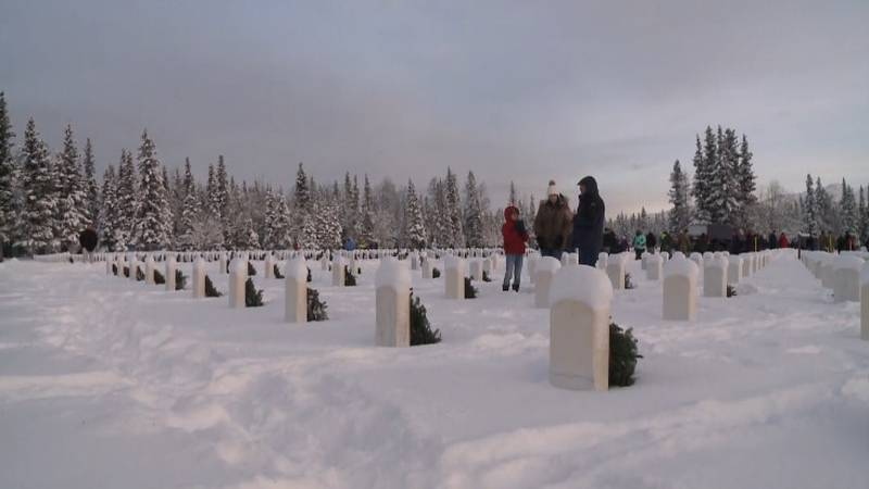 In this file photo, wreaths are placed on graves at Fort Richardson National Cemetery during...