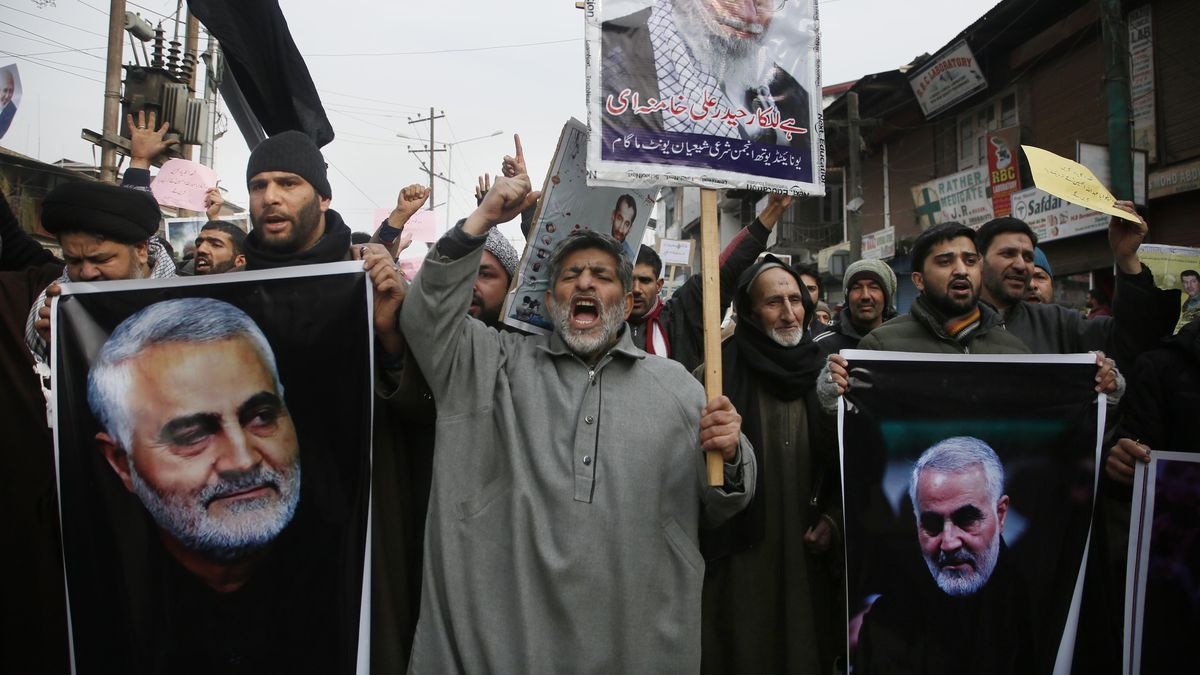 In this Friday, Jan. 3, 2020, file photo, Kashmiri Shiite Muslims shout anti American and anti Israel slogans during a protest against U.S. airstrike in Iraq that killed Iranian Revolutionary Guard Gen. Qassem Soleimani, seen in the photographs, at Magam 37 kilometers (23 miles) north of Srinagar, Indian controlled Kashmir.