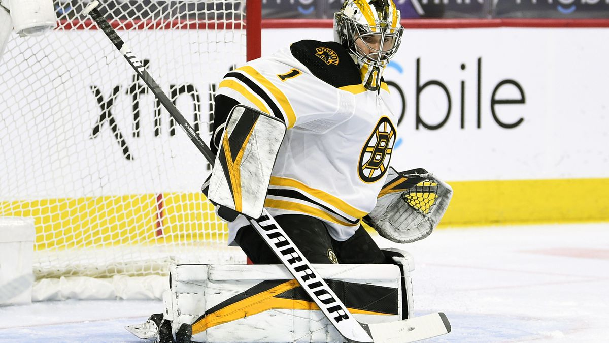 Boston Bruins goaltender Jeremy Swayman makes pad save on a shot during the first period of an...