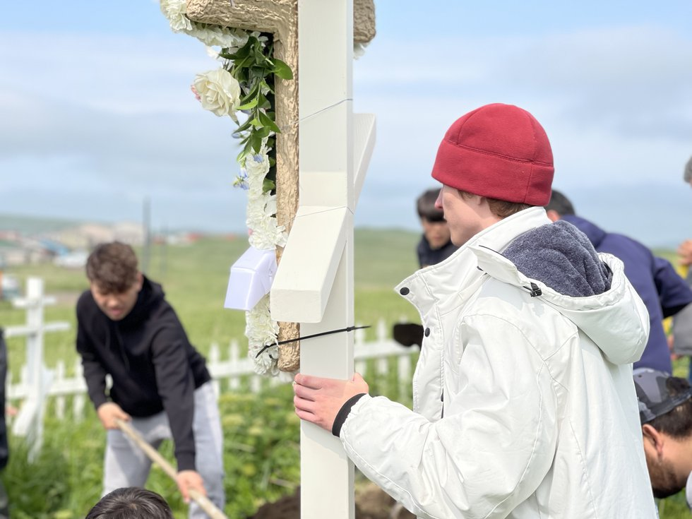Lucas Peters carries the cross for the funeral of Sophia Tetoff in St. Paul, Alaska. Tetoff was...