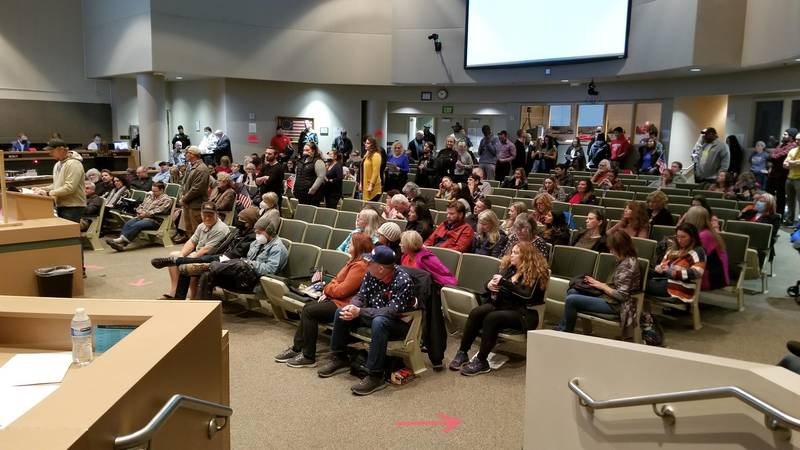 Residents prepare to testify on a proposed mask ordinance before the Anchorage Assembly on...
