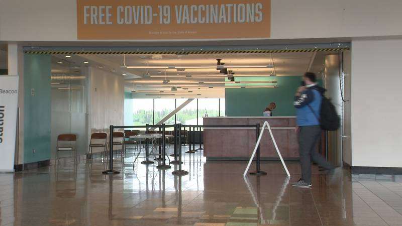 A clinic at the Ted Stevens Anchorage International Airport offers COVID-19 shots for tourists.