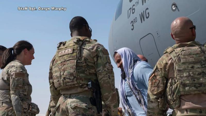 Members of the 176th Wing and active-duty 3rd Wing deliver Afghan evacuees to Iraq.