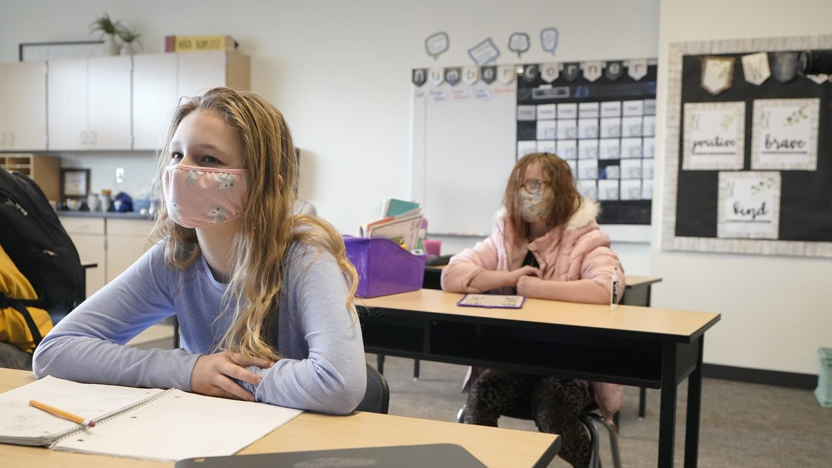 Students wear masks they work in a fourth-grade classroom, Tuesday, Feb. 2, 2021, at Elk Ridge...