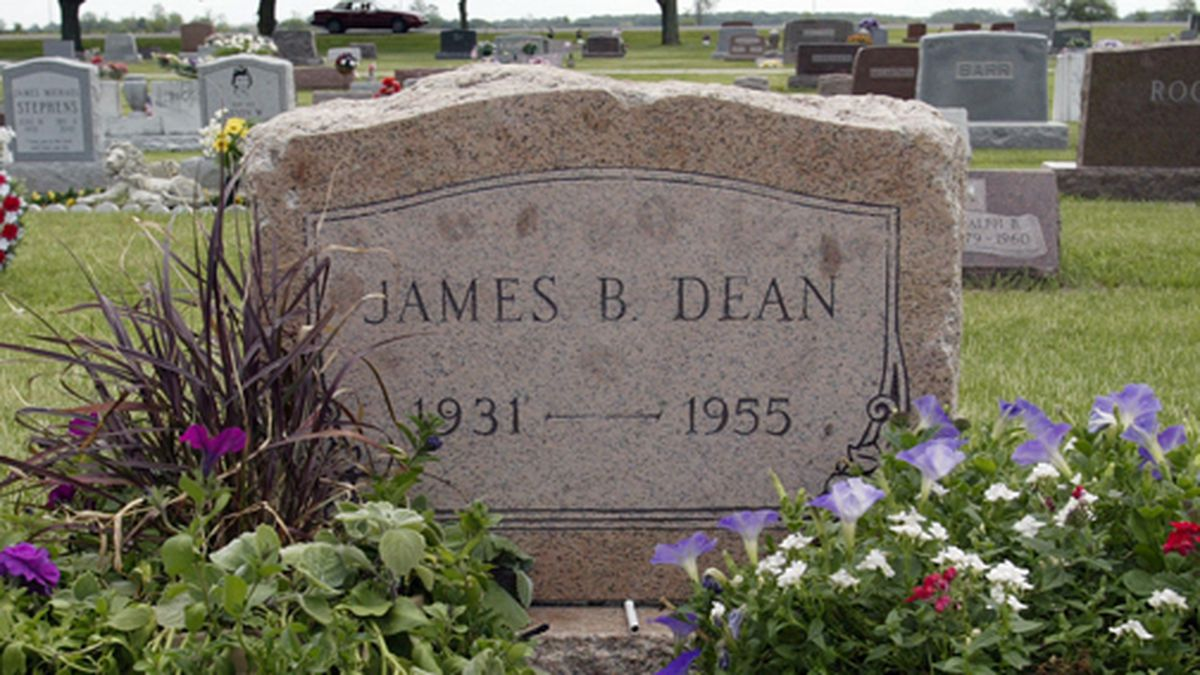 "This May 27, 2005 file photo shows plants and flowers at the grave of actor James Dean in Fairmount, Ind. Dean hasn't been alive in 64 years, but the ""Rebel Without a Cause"" actor has been cast in a new film about the Vietnam War. The filmmakers behind the independent film ""Finding Jack"" said Wednesday that a computer-generated Dean will play a co-starring role in the upcoming production. The digital Dean is to be assembled through old footage and photos and voiced by another actor. (AP Photo/John Harrell, File)"