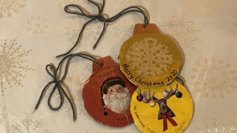 A trio of ornaments made from recycled cardboard, paint and junk holiday mail await their send...