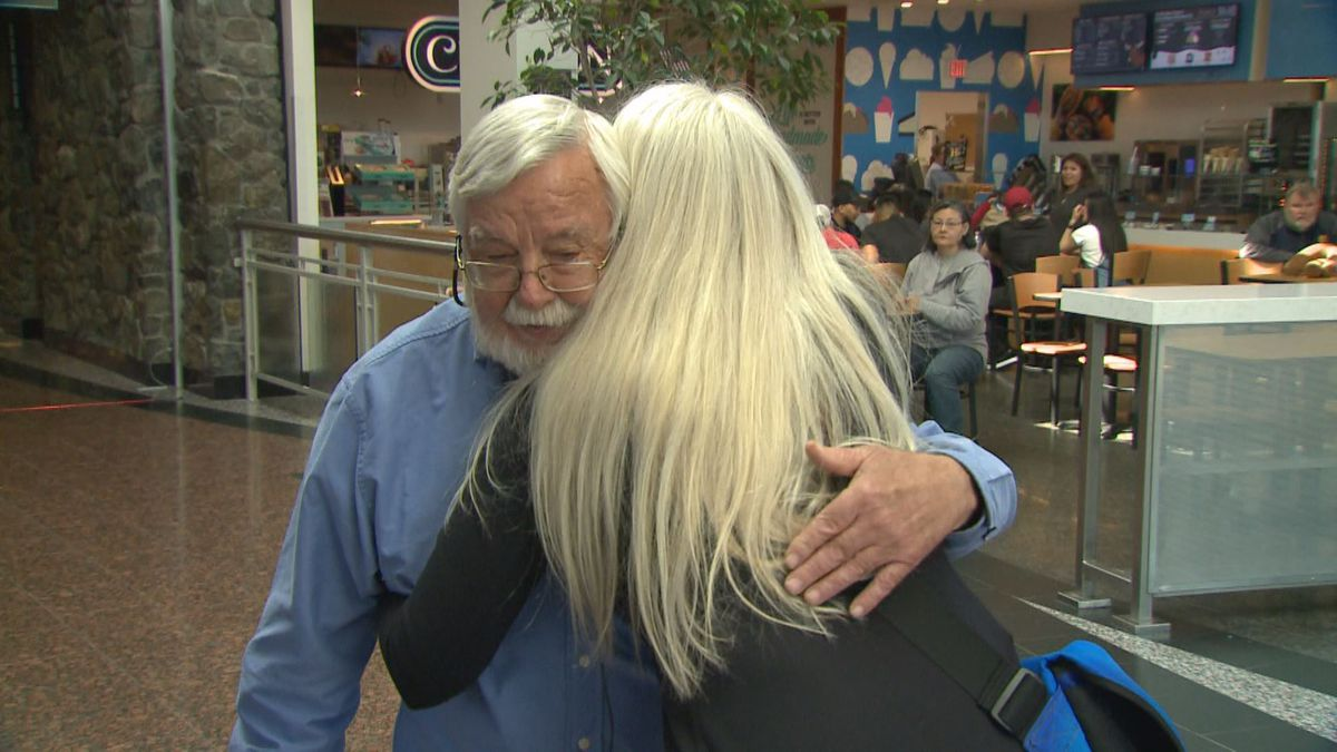 Corrine Danzl and her biological father Dave Zuidmuller meet for the first time in the Anchorage airport.