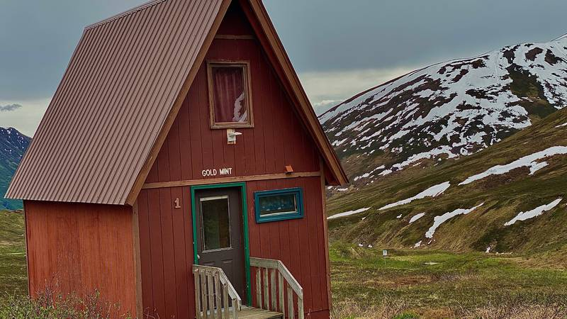 One of Hatcher Pass Lodge's rustic cabins rests in between the scenic views of the Talkeetna...
