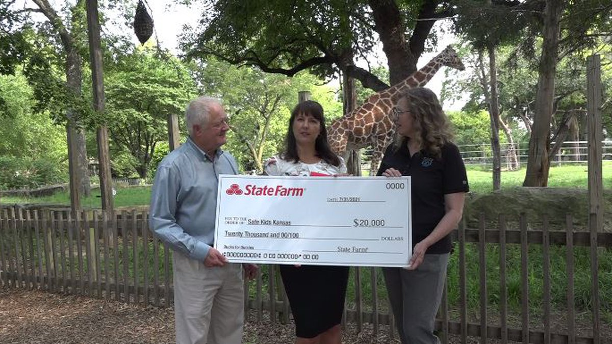 From left, State Farm Insurance representatives Paul Davault and Jamie Hornbaker along with...