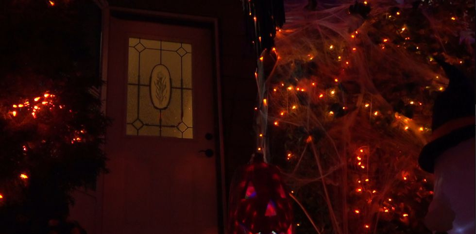 Shelle Shaw's front door where she'll be handing out candy directly to kids while wearing a...