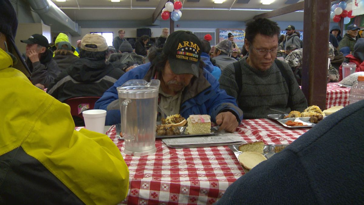 Veterans enjoy a specially-prepared Veterans Day Meal. Veterans were assigned tables at the front of the dining area and allowed to eat first.