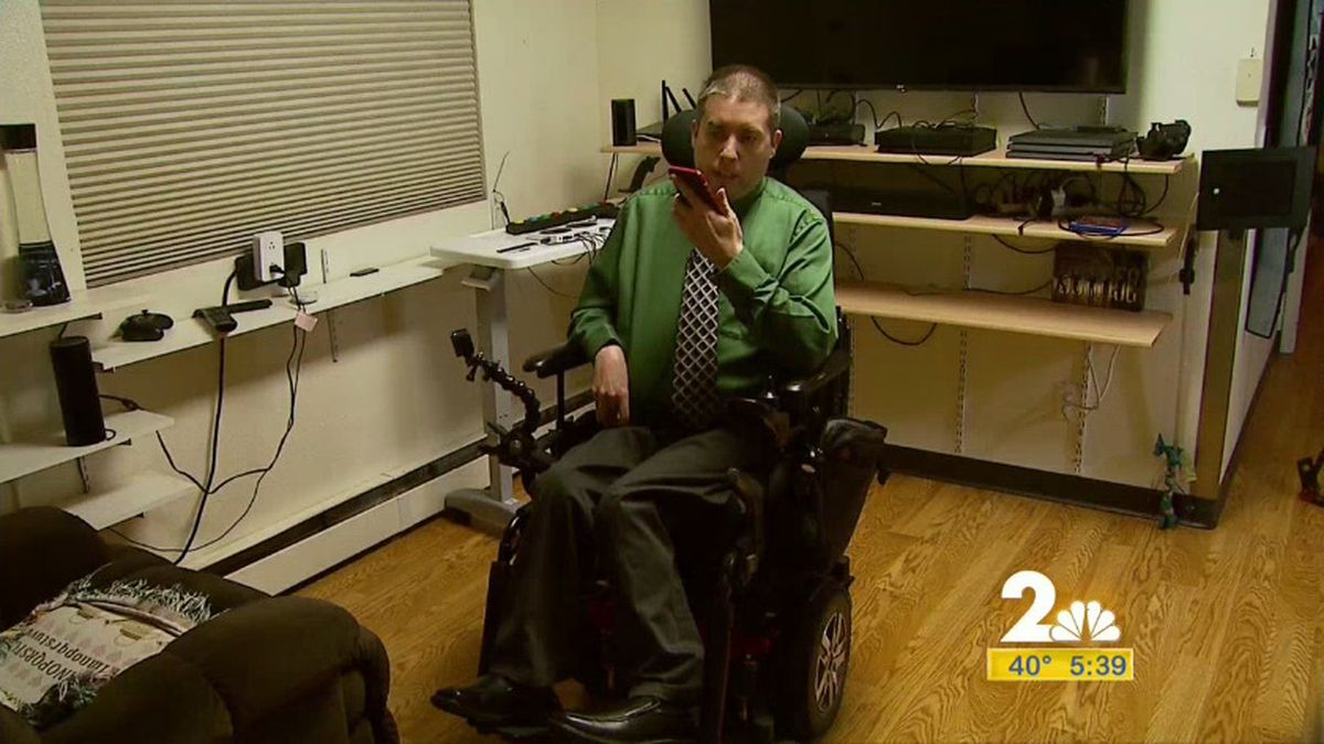 Peer advocate, Travis Noah using his smartphone to control different things in his home. It's an adaptive technology that's helping him live more independently.