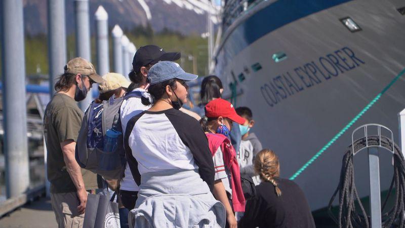 Passengers wait to board the Kenai Fjords Tours' Coastal Explorer headed to Fox Island.