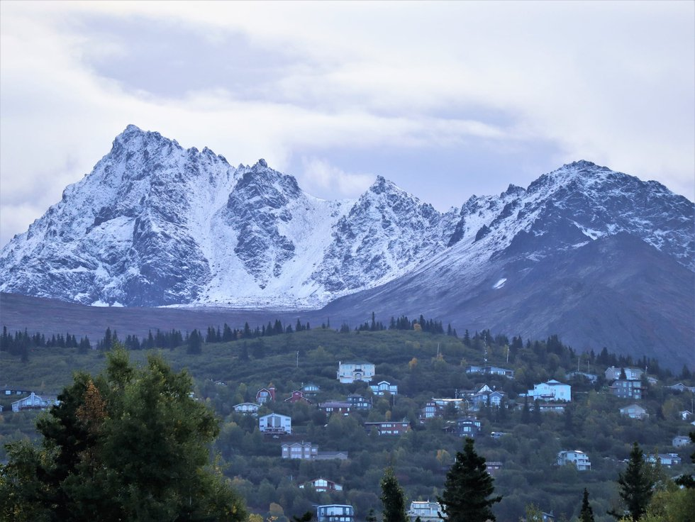 Snow collected on peaks of the Chugach Range in Anchorage Tuesday 9-14-21