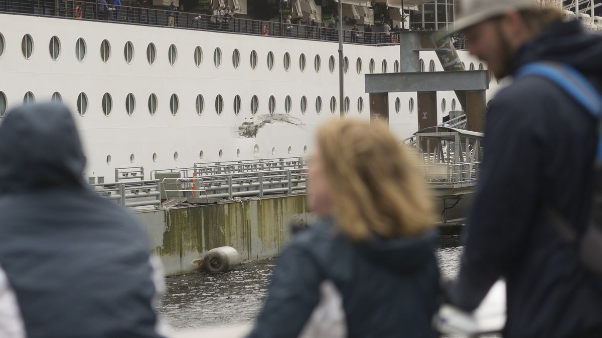 People look at damage to the Celebrity Infinity early Friday afternoon at Berth 3 in Ketchikan. The cruise ship damaged Berth 3 while docking, rendering it unusable. Staff photo by ketchikan Daily News/ Nick Bowman