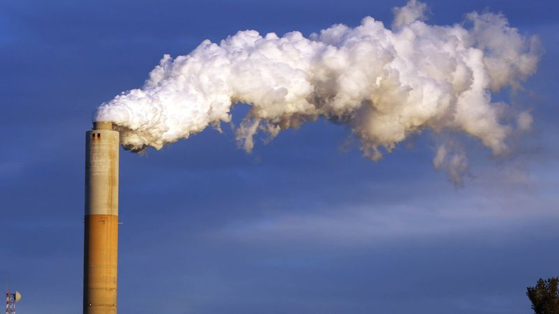 FILE - In this Jan. 20, 2015 file photo, steam billows from the chimney or a coal-fired...