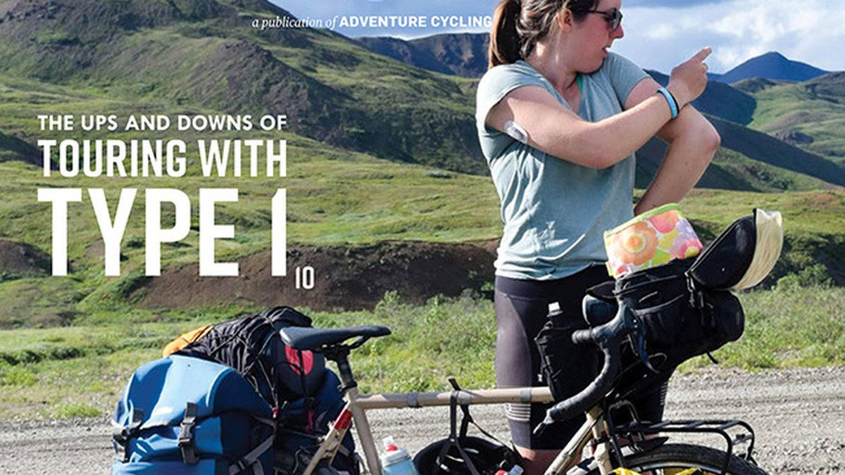 Annalisa Van Den Bergh on the cover of April's issue of Adventure Cyclist Magazine.