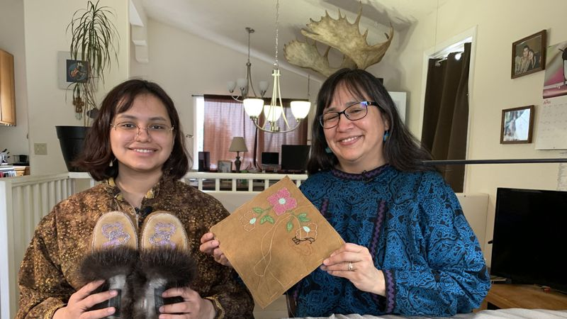 Angela and Ermelina Gonzalez show off the Athabascan beadwork Ermelina  will wear at graduation...