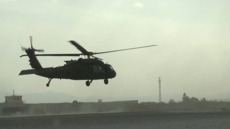 An army helicopter flies over Afghanistan.