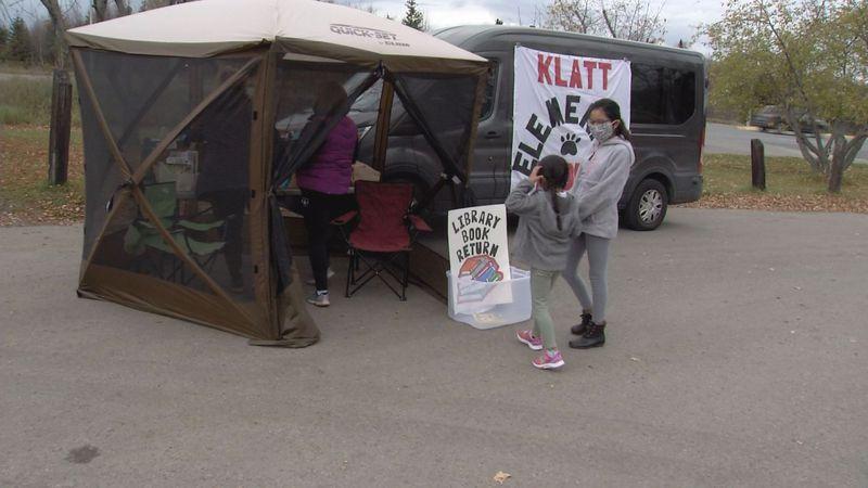 Klatt Elementary students take advantage of the book mobile at Dimond Estates Trailer Court.