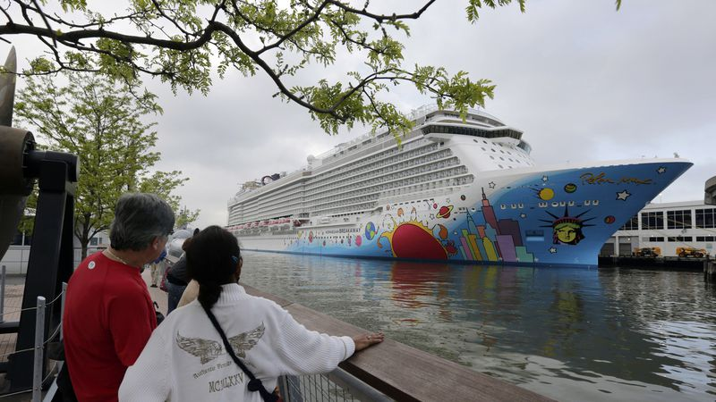 FILE - In this May 8, 2013 file photo, people pause to look at a Norwegian Cruise Line ship,...