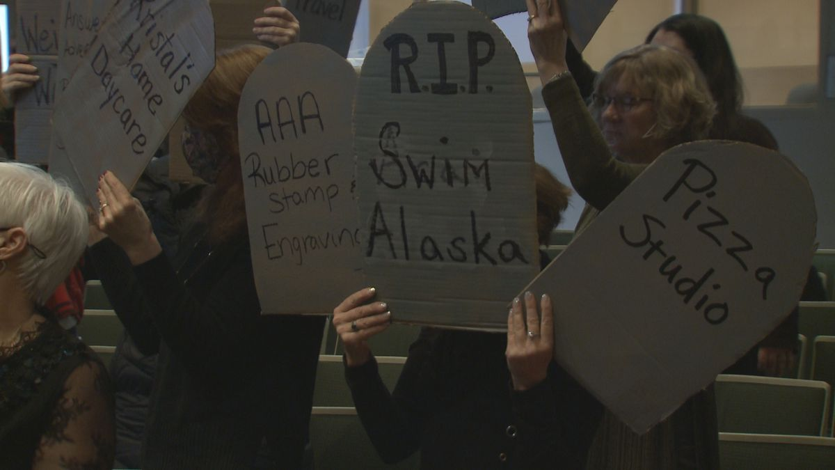 Anchorage small business owners held up cardboard tombstones in front of the Anchorage Assembly...