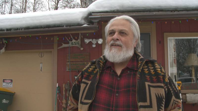 Eagle River resident Michael Childers lights up his Eagle River home with Christmas lights...