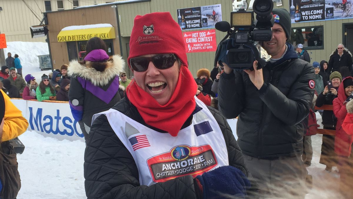 Aliy Zirkle crosses the Iditarod finish line in Nome, March 13, 2019 (KTUU)